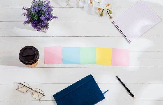 colorful sticky notes and journal on a desk