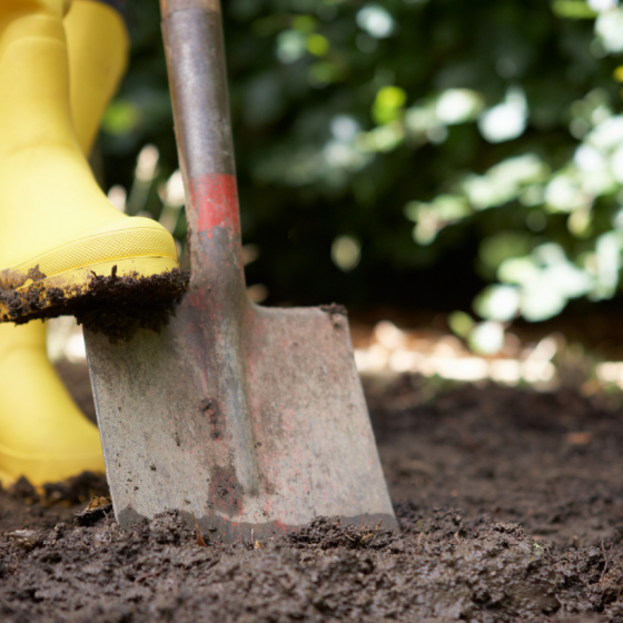 gardening yellow boots shovels soil